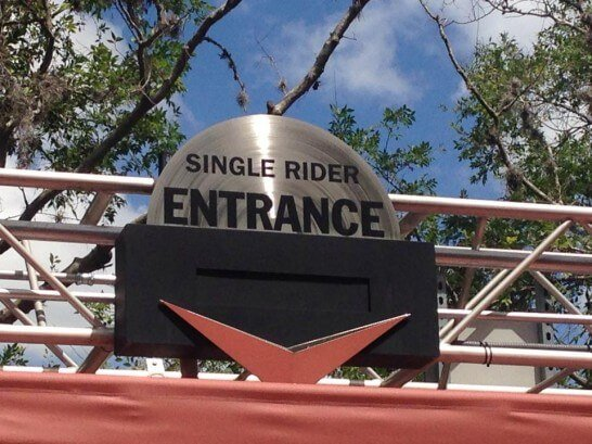 A sign shows where single riders can enter Rock n Roller Coaster at Walt Disney World. Single Rider lines are great options on a solo trip to Disney world.