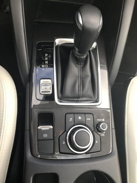 Center console volume controls in the Mazda CX-5