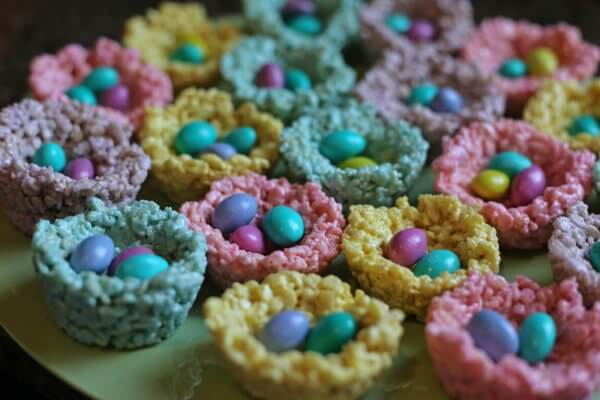 Brightly colored Rice Krispy treat birds nests made with marshmallow Peeps are a simple and cute easter treat