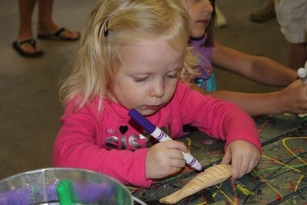 a child does a craft at Disney's Hilton Head island resort's community hall