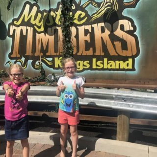 Two girls pose with thumbs up after riding Kings Island's new roller coaster, Mystic Timbers