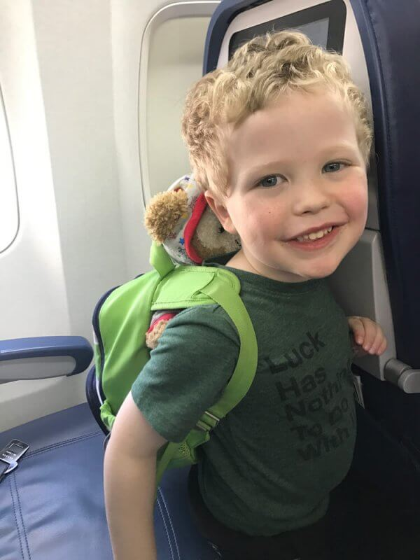 Preschooler carries activities on the plane to keep him entertained during a flight