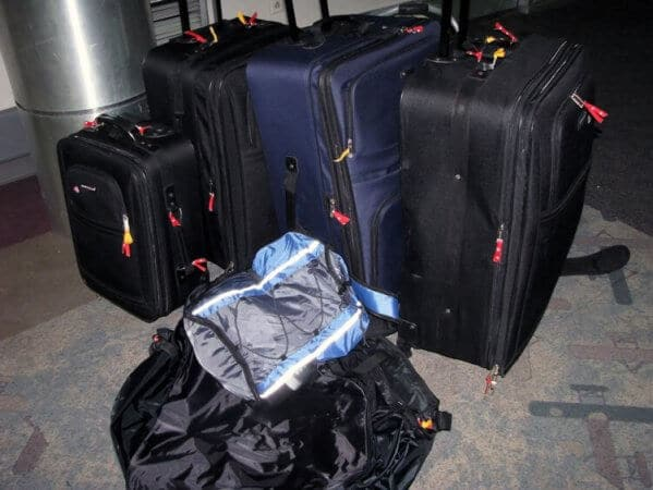 a pile of luggage for a family that overpacked
