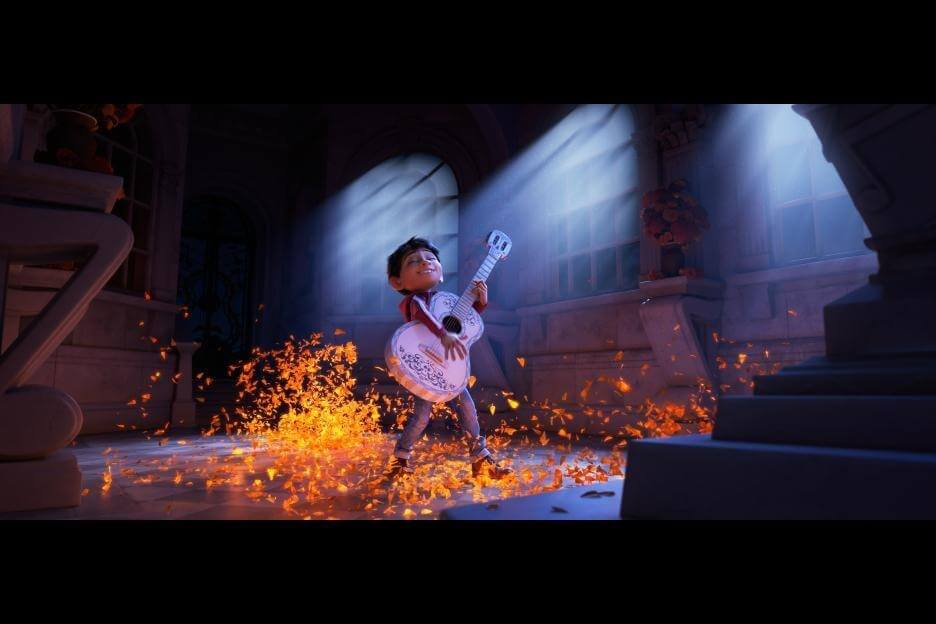 Young Miguel from Disney Pixar's upcoming film COCO plays a beautiful white guitar, with magical sparks all around him.
