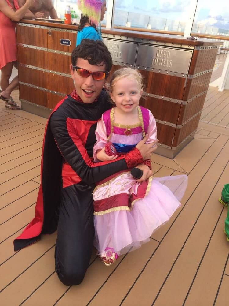 Disney Cruise Line Halloween Deck Party cast member in superhero costume with little girl in Mulan costume