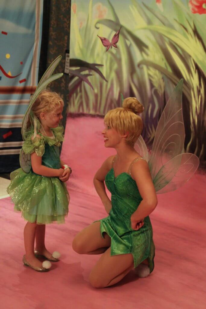 little girl dressed as Tinker Bell meets the real Tinker Bell on the Disney Fantasy