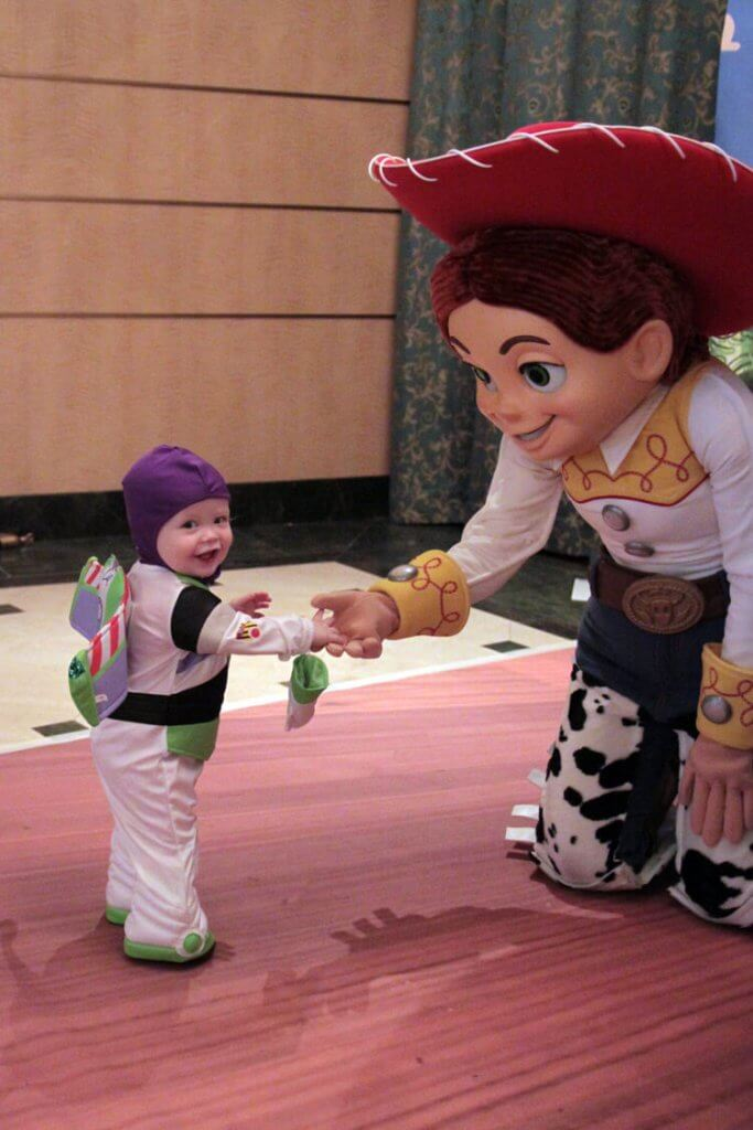 Young boy dressed as Buzz Lightyear meets Jessie from Toy Story on the Disney Fantasy