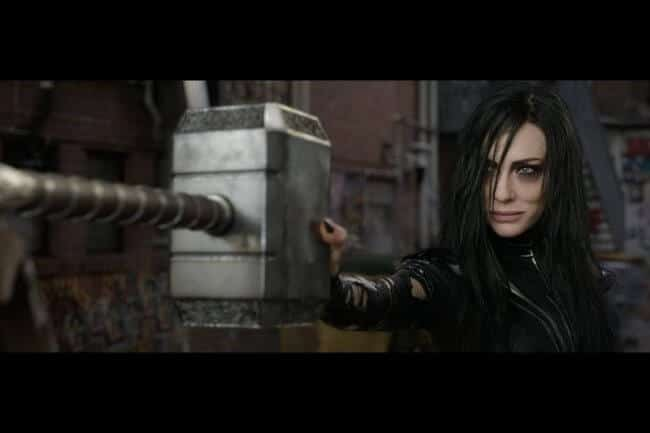 dark-haired Cate Blanchett as Hela, goddess of death, in Marvel's Thor: Ragnarok, shown resisting Thor's powerful hammer