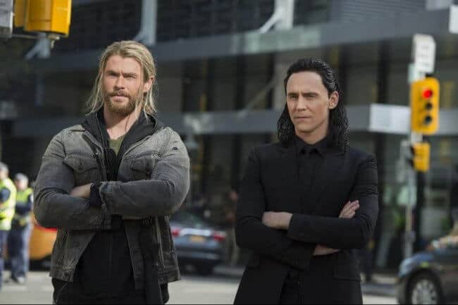 Chris Hemsworth and Tom Hiddleston as Thor and Loki, with arms crossed in sibling rivalry, from Thor: Ragnarok