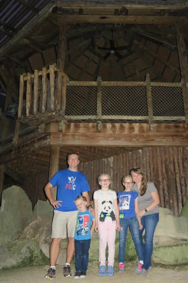 A family inside the Giraffe Ridge exhibit at the Cincinnati Zoo during the Twiga Overnight program