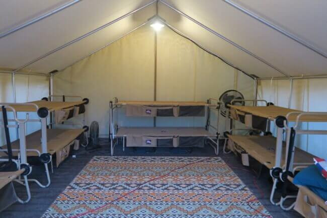 The interior of the tent at the Cincinnati Zoo Twiga Overnight, with 5 bunk beds (sleeps 10), outlets, lights, etc