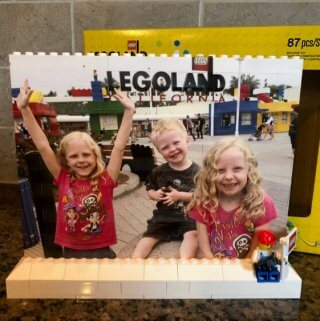 A photo of three kids at Legoland printed on a Lego Brick Wall photo gift from Magic Memories