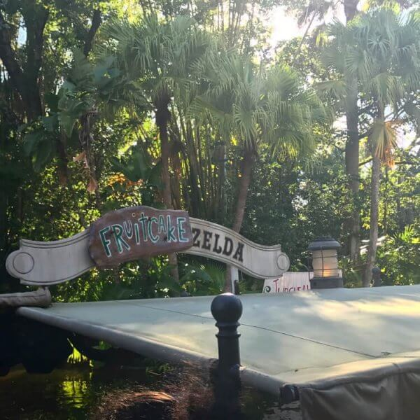 sign on Jungle Cruise boat for Jingle Cruise (christmas) that says Fruitcake Zelda