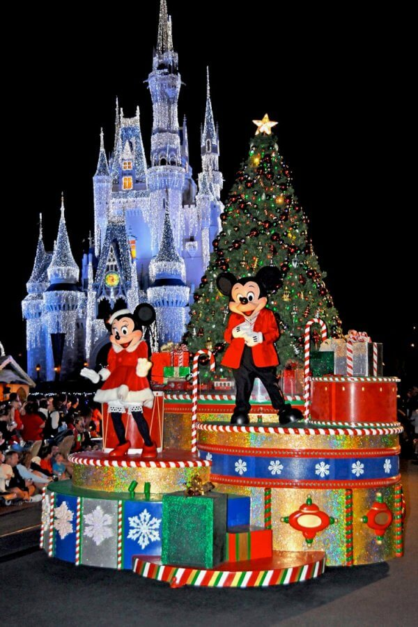 Mickey and Minnie with a Christmas tree on a Christmas parade float