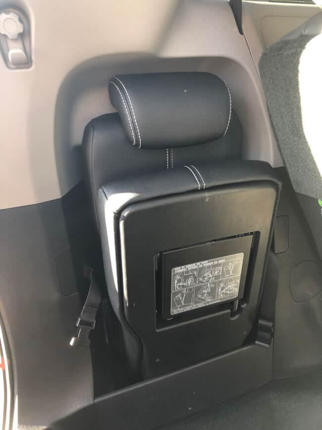 Extra seat stowed in the trunk of a 2017 Toyota Sienna