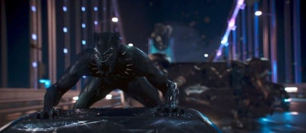 Black Panther rides on top of a car during a car chase scene in the latest Marvel movie, Black Panther; one of many action scenes in the movie