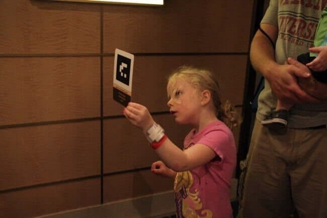a preschool girl plays the interactive Midship Detective Agency game (free!) onboard the Disney Fantasy