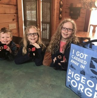 three kids and a swag bag from Pigeon Forge, Tennessee, taken in a cabin in the Eagles Ridge Resort