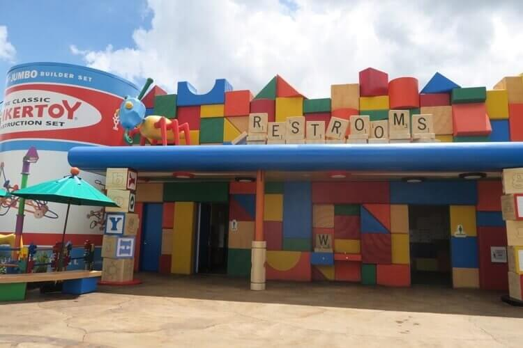 Toy Story Land cootie bathrooms made of block walls and with scrabble tiles for signs
