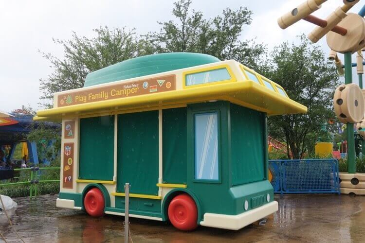 Fisher Price Family Camper and Toy Dump Truck toy cars are the merchandise carts in Toy Story Land
