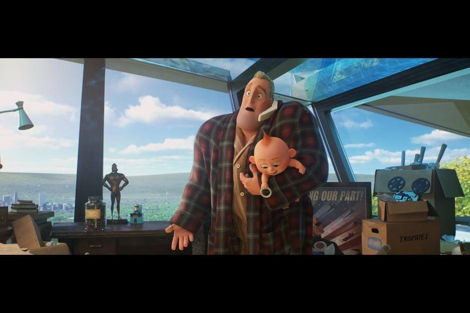Bob Parr holds jack jack as he checks in with Helen Parr in Incredibles2