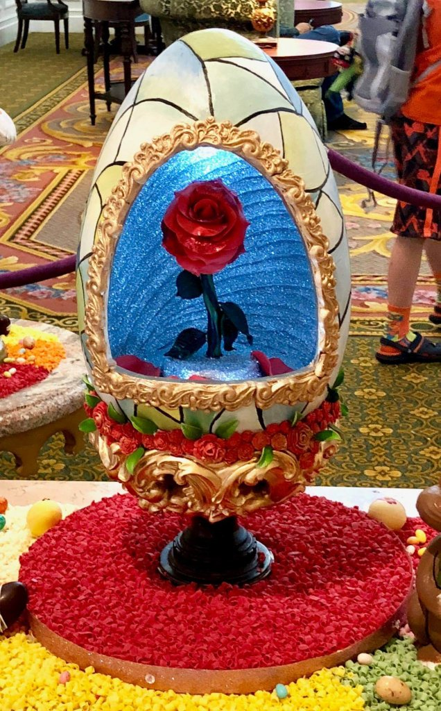 beauty and the beast rose painted/sculpted onto beautiful Easter egg at Walt disney world's grand Floridian
