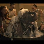 live action dumbo getting a bubble bath in Tim Burton's 2019 film