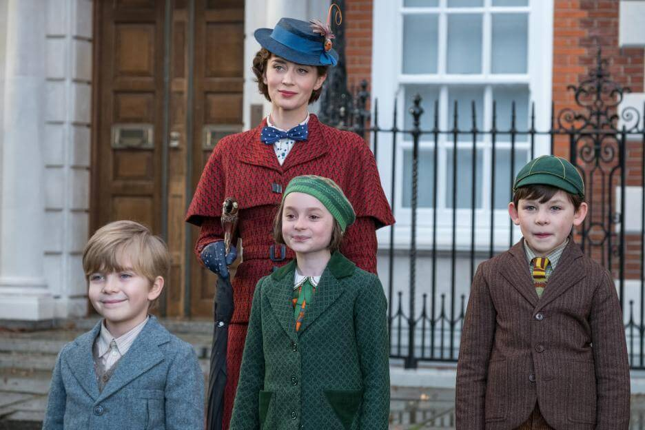 Emily Blunt as Mary Poppins in Mary Poppins Returns, standing with John, Annabelle, and Georgie Banks on 13 Cherry Tree Lane