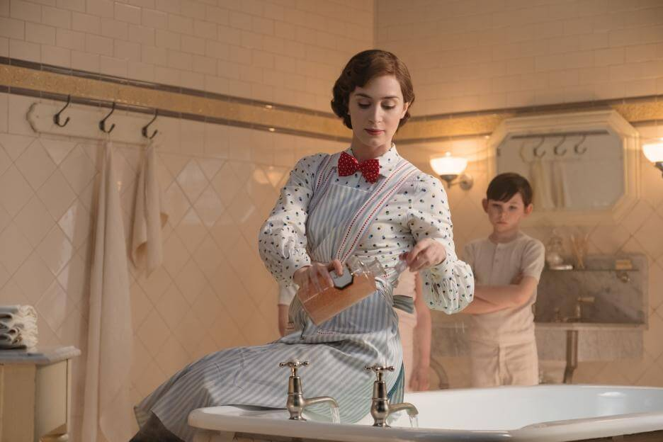 Emily Blunt, Mary Poppins, in Mary Poppins returns. she is sitting on a bathtub trying to convince Georgie, John, and Annabelle Banks to get a bath.
