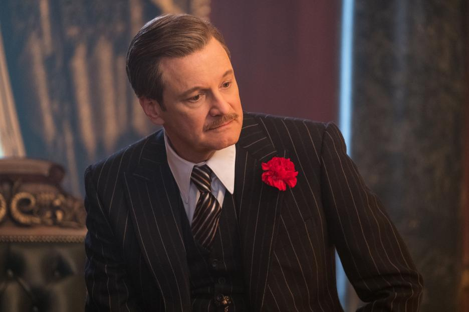 Colin Firth in a pinstriped suit as a banker in Mary Poppins Returns