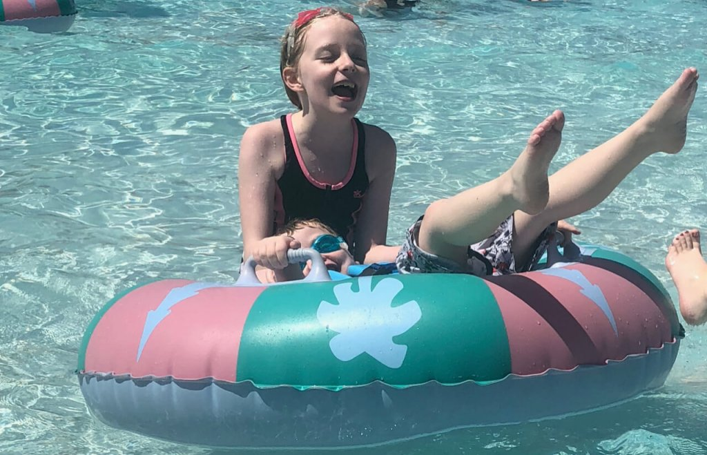 two children in an inner tube in the wave pool at Walt Disney World's Blizzard Beach water park