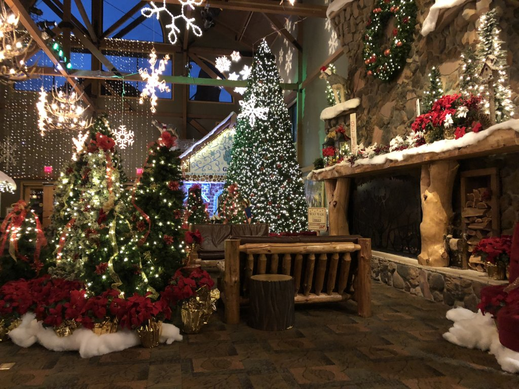 the hotel lobby is decorated for the Christmas Holidays at Great Wolf lodge