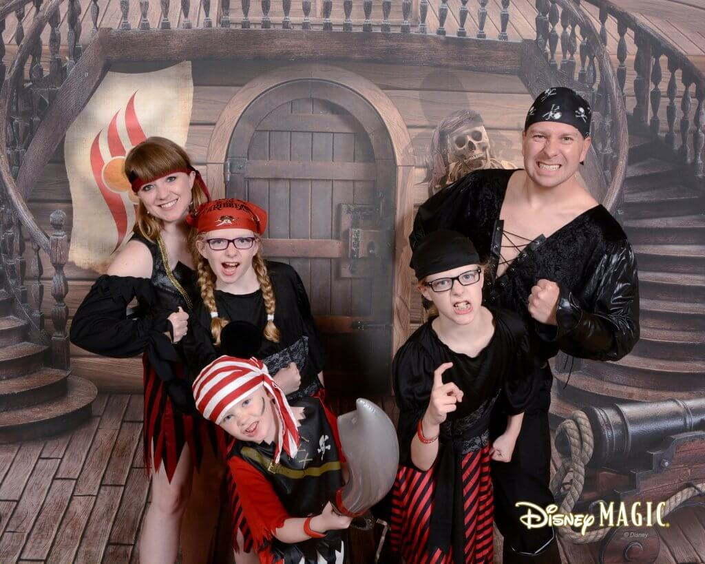 On a first Disney Cruise, people may not know that families dress up for pirate night, Star Wars day at sea, etc; pirate night photo op and background