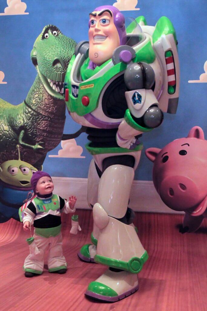 small toddler boy dressed as buzz lightyear, meeting buzz light-year on his first Disney Cruise