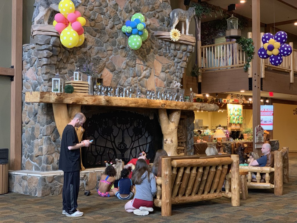 Families gather in a Great Wolf Lodge lobby for their Spring-A-Palooza Easter Celebration