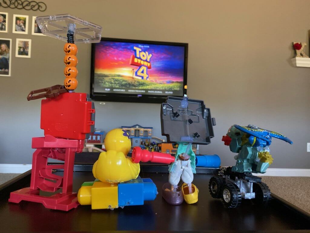"upcycled toys getting ready to ""watch"" toy story 4 on a TV"
