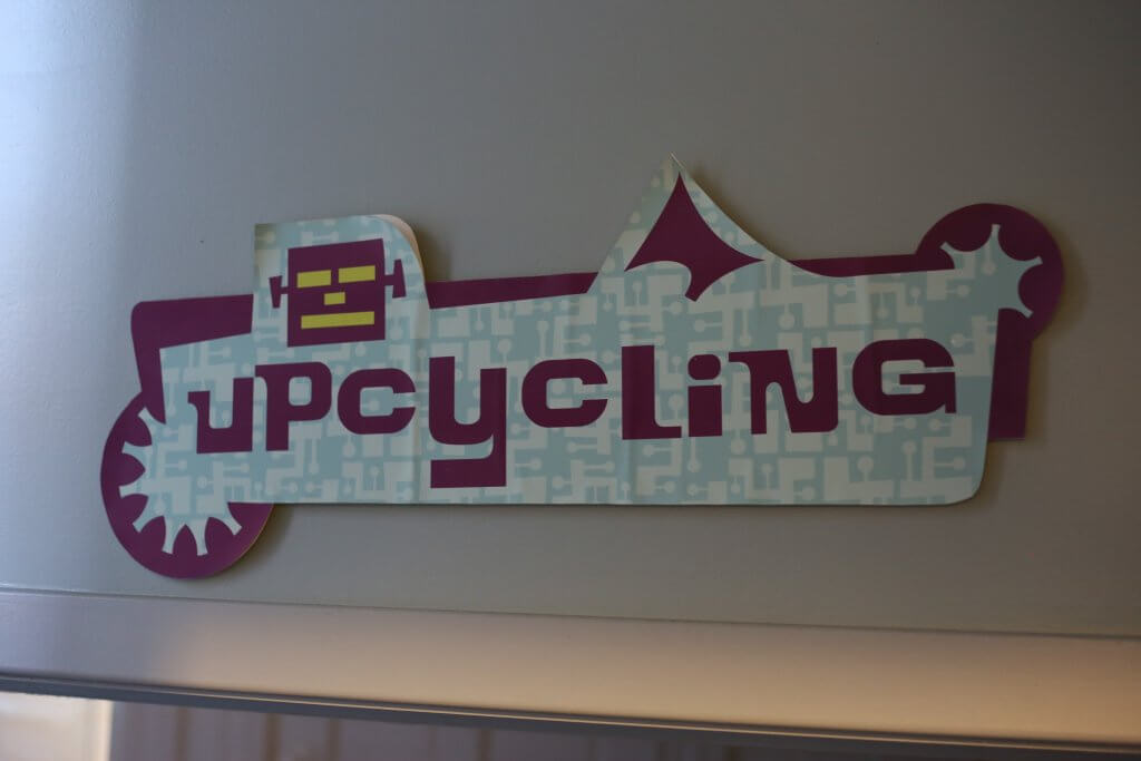 a sign about upcycling toys at Happen Inc in Cincinnati