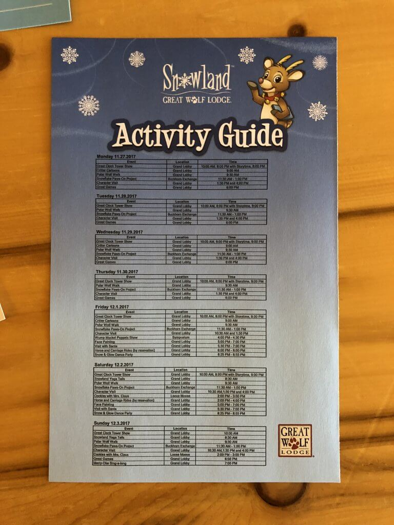 paper activity guide/schedule with blue snow land theme and Great Wolf Lodge clipart