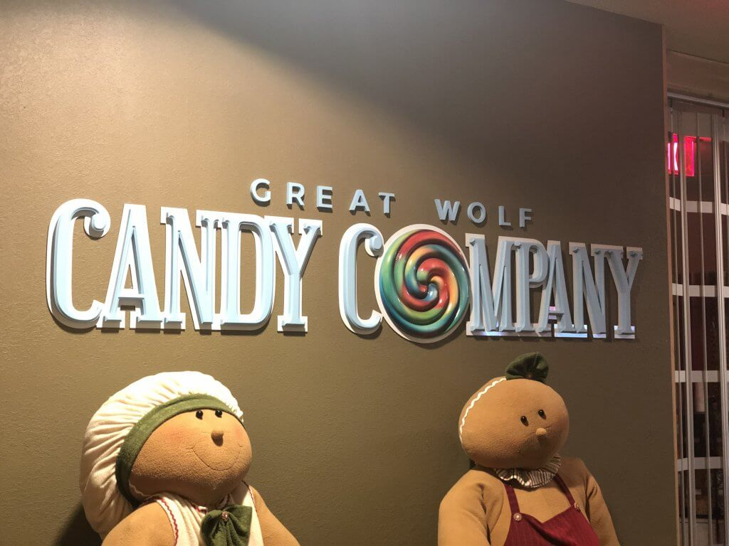 entrance sign to Great Wold Candy Company shop, as well as two gingerbread figures outside the store