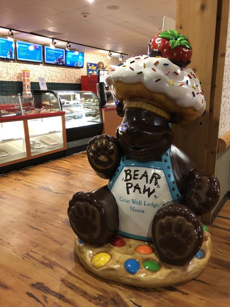 bear-shaped entrance statue for Bear Paw Sweet Eats and Treats at Great Wolf Lodge Mason