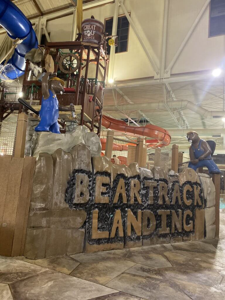 "fake stone work that says ""beartrxck landing"", plus the front entrance of the Great Wolf Lodge waterpark"