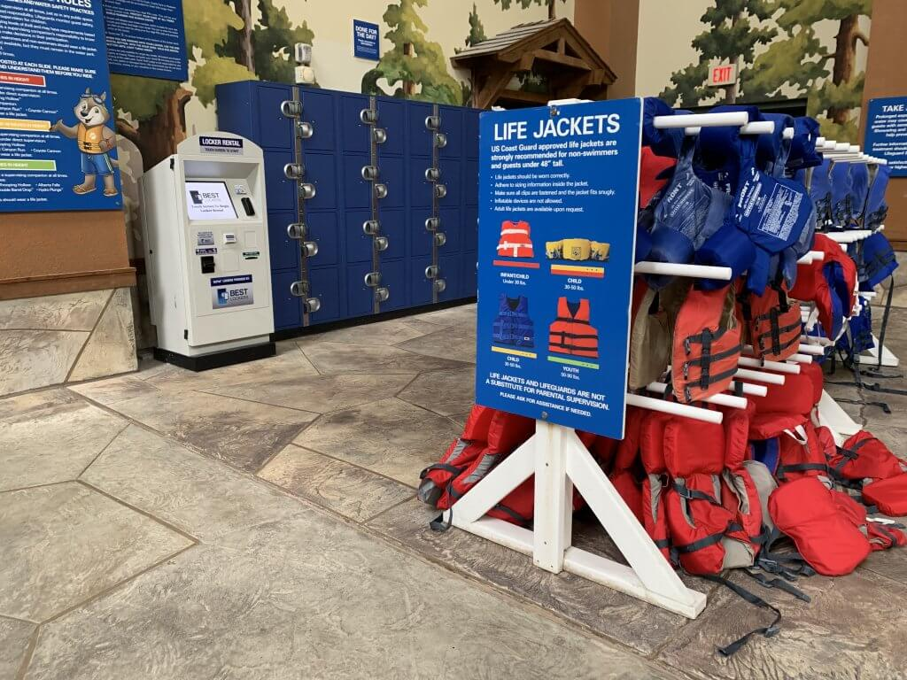 Life jackets and a locker bay, as well as safety signage, inside a Great Wolf Lodge waterpark